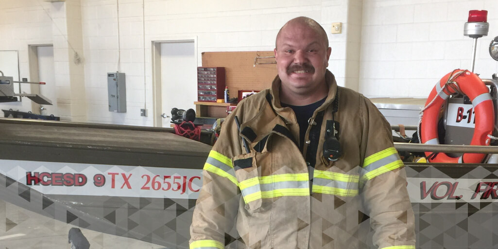 Marcus Capozzelli Smiles at the Local Firehouse in his firefighting gear.