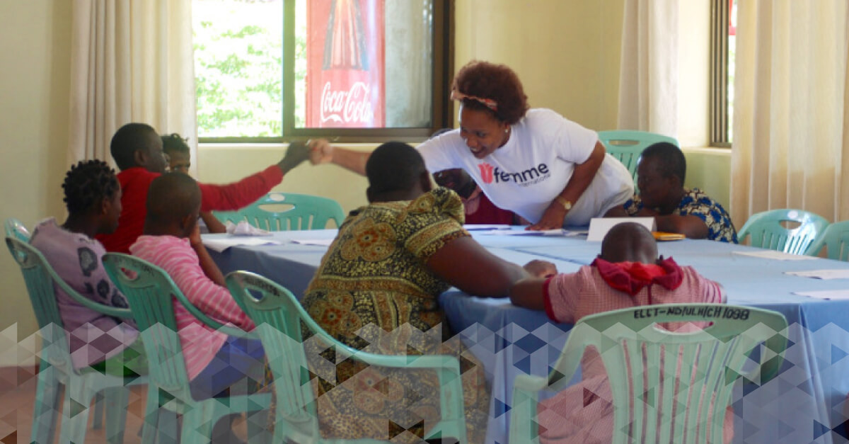 Young women and girls with disabilities learn about feminine hygiene in Tanzania.