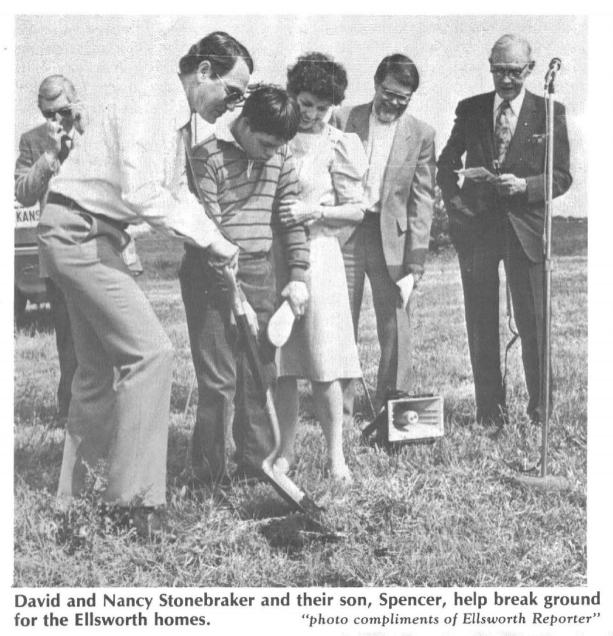 David and Nancy Stonebraker and their son, Spencer, help break ground for the Ellsworth homes.