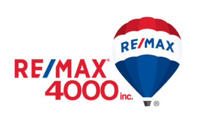 Remax 4000 logo: Red text says Remax 4000 Inc. with a blue backslash in between re and max. Next to it is a hot air balloon with a red, blue and white stripes. On it is the word Remax in blue with a red backslash between re and max.